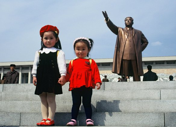Many visitors go out to the monuments on Mansu hill. It is traditional to lay flowers there and bow to the statues of the leaders. On this day some Korean families, including the children whose picture I took, were following those traditions. The fashion of their clothing reminded me of the style of the 1940s and '50s in the western world. The North Korean population has quite its own fashion style.