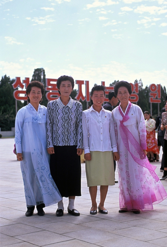 I met these nice women in traditional clothes at the Kumsusan Memorial Palace (the Mausoleum of Kim Il Sung); on official holidays and anniversaries the women wear traditional Korean garments and the men wear suits. This was on the day of Kim Il Sung's birthday. For North Koreans, Kim Il Sung is not dead; he still lives in their hearts. For Westerners it's hard to believe, but everybody says it!